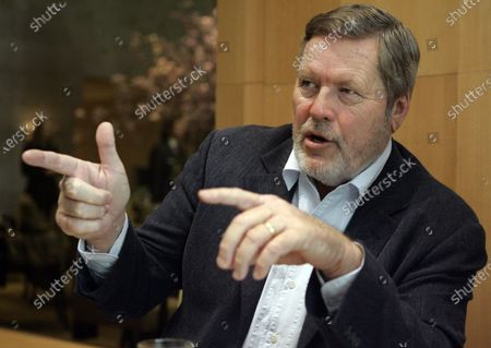 """John Langley, creator of television's """"Cops,"""" gestures during an interview in New York. Langley has died during a road race in Mexico, a family spokeswoman said. Langley died in Baja, Mexico, of an apparent heart attack, during the Coast to Coast Ensenada-San Felipe 250 off-road race, family spokeswoman Pam Golum said. He was 78"""