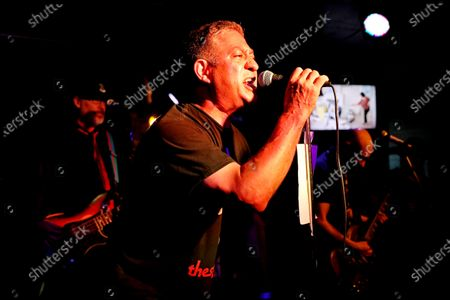 """Stock Image of Vince Velasco, of Irvine, sings """"I Don't Care About You"""" by Fear at Punk Rock Karaoke at Gallagher's Pub HB on Sunday, June 13, 2021 in Huntington Beach, CA. Since 1996 Punk Rock Karaoke band members play live music while aficionados karaoke to selected songs. Punk Rock Karaoke band members; Greg Hetson (Bad Religion, Circle Jerks): Guitar-Vocals, Stan Lee (The Dickies): Guitar, Randy Bradbury (Pennywise): Bass-Vocals and Darrin Pfeiffer (Goldfinger) Drums-Vocals. (Gary Coronado / Los Angeles Times)"""