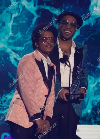 Bruno Mars, left, and Anderson .Paak, of Silk Sonic, accept the best group award at the BET Awards, at the Microsoft Theater in Los Angeles