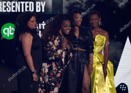 Michelle Buteau, from left, Jill Scott, Michelle Mitchenor and Ryan Michelle Bathe present the best new artist award at the BET Awards, at the Microsoft Theater in Los Angeles