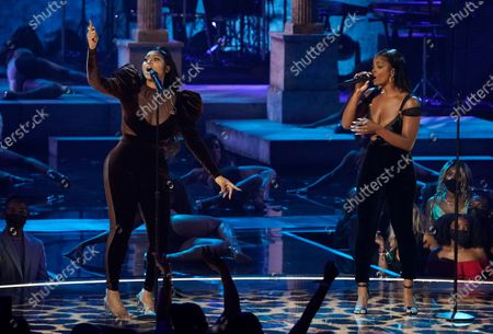 Jazmine Sullivan, left, and JT, of City Girls, perform at the BET Awards, at the Microsoft Theater in Los Angeles