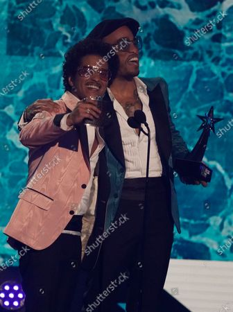 Stock Picture of Bruno Mars, left, and Anderson .Paak, of Silk Sonic, accept the best group award at the BET Awards, at the Microsoft Theater in Los Angeles