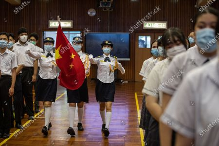 Students at the Hong Kong Federation of Education Workers Wong Cho Bau Secondary School carry the Chinese national flag as they take part in a weekly flag raising ceremony in Hong Kong, China, 07 June 2021 (issued 28 June 2021). Leaders of the Hong Kong Special Administrative Region (SAR) are expected to be in Beijing this week to attend centenary events for the communist party. China will celebrate the 100th founding anniversary of its ruling Chinese Communist Party (CCP) on 01 July 2021.