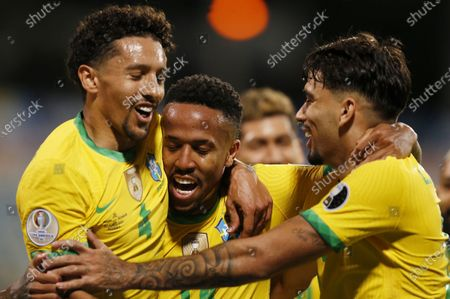 (210628) - GOIANIA, June 28, 2021 (Xinhua) - Brazil's Eder Militao (C) celebrates with teammates Marquinhos (L) and Lucas Paqueta during the 2021 Copa America group B football match between Brazil and Ecuador in Goiania, Brazil, on June 27, 2021.