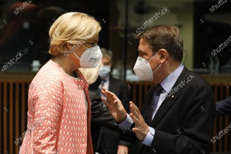 German Minister of Food and Agriculture Julia Klockner (L) talks with Spanish Minister for Fisheries Luis Planas (R) at the start of the Agriculture and Fisheries council meeting in Luxembourg, 28 June 2021. EU Ministers will discuss the reform of the Common Agricultural Policy (CAP) but also biological control agents and the need to set a specific goal to protect bees.