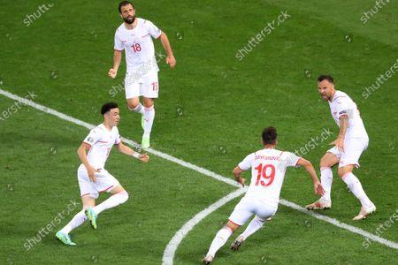 Switzerland players celebrate the equalising goal scored by Mario Gavranovic