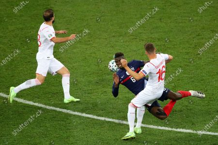 Stock Picture of Paul Pogba of France looses the ball under pressure from Christian Fassnacht of Switzerland in the build up to the third Swiss goal