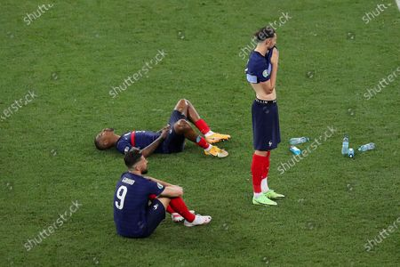 Adrien Rabiot, Olivier Giroud and Presnel Kimpembe of France reacts after loosing the penalty shoot out to Switzerland