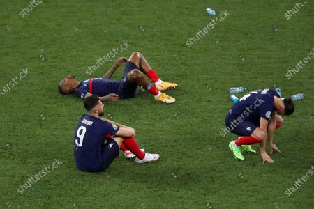 Olivier Giroud, Adrien Rabiot and Presnel Kimpembe of France look dejected at the end of the game