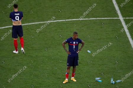 Olivier Giroud and Presnel Kimpembe of France look dejected at the end fo the game