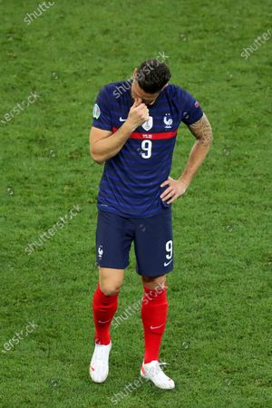 Olivier Giroud of France shows a look of dejection at the end of the game