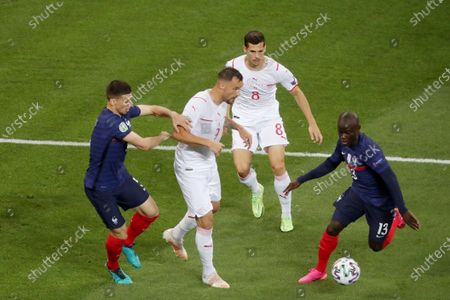 Clement Lenglet and Ngolo Kante  of France complete with Haris Seferovic of Switzerland