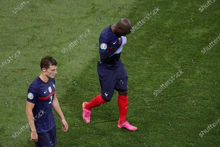 Benjamin Pavard and Ngolo Kante of France show a look of dejection