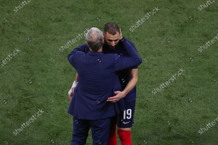 Karim Benzema of France is hugged by manager Didier Deschamps after being substituted for Olivier Giroud