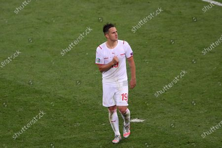 Mario Gavranovic of Switzerland celebrates scoring his penalty