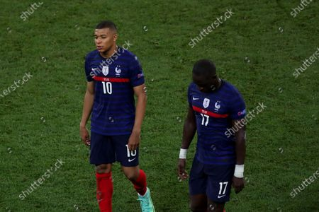 Stock Picture of Kylian Mbappe and Moussa Sissoko of France shows a look of dejection at the full time whistle