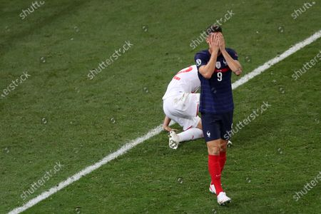 Olivier Giroud of France reacts after missing a chance to score