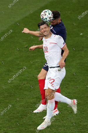Olivier Giroud of France and Fabian Schar of Switzerland