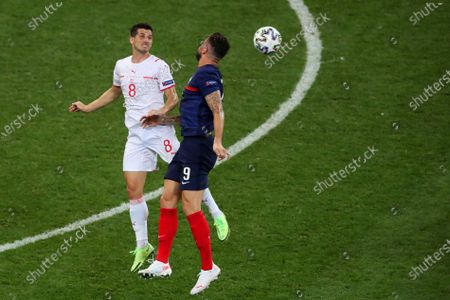 Remo Freuler of Switzerland and Olivier Giroud of France
