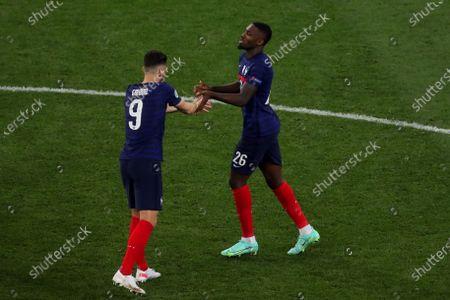 Olivier Giroud of France and Marcus Thuram