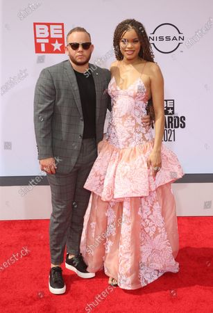 Stock Image of Andra Day and brother