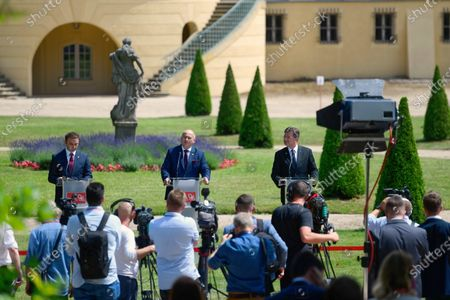 Stock Image of (L-R) Foreign Minister of North Macedonia Bujar Osmani, Polish Minister Zbigniew Rau and EU Special Representative for the Belgrade-Pristina Dialogue and other Western Balkan regional issues Miroslav Lajcak attend a press conference after the Visegrad Group and Western Balkans foreign ministers meeting in Rogalin, western Poland, 28 June 2021. Foreign Ministers discussed the EU enlargement policy, cooperation in the context of the COVID-19 pandemic and post-pandemic recovery, as well as strengthening regional partnership.