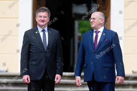 Polish Foreign Minister Zbigniew Rau (R) and EU Special Representative for the Belgrade-Pristina Dialogue and other Western Balkan regional issues Miroslav Lajcak (L) during official welcome ceremony before the Visegrad Group and Western Balkans foreign ministers meeting in Rogalin, western Poland, 28 June 2021. V4 Foreign ministers will discuss the EU enlargement policy, cooperation in the context of the COVID-19 pandemic and post-pandemic recovery, as well as strengthening regional partnership.