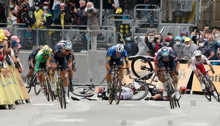Slovakia's Peter Sagan, left, crashes with Australia's Caleb Ewan, right, during the sprint towards the finish line of the third stage of the Tour de France cycling race over 182.9 kilometers (113.65 miles) with start in Lorient and finish in Pontivy, France