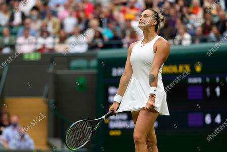 Belarus's Aryna Sabalenka reacts after losing a point to Romania's Monica Niculescu during their first round women's singles match on day one of the Wimbledon Tennis Championships in London