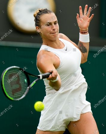 Belarus's Aryna Sabalenka returns a ball to Romania's Monica Niculescu during their first round women's singles match on day one of the Wimbledon Tennis Championships in London