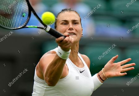 Belarus's Aryna Sabalenka returns the ball to Romania's Monica Niculescu during their first round women's singles match on day one of the Wimbledon Tennis Championships in London