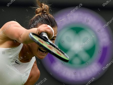 Belarus's Aryna Sabalenka serves to Romania's Monica Niculescu during their first round women's singles match on day one of the Wimbledon Tennis Championships in London