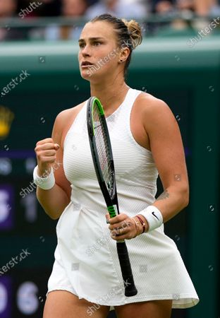 Belarus's Aryna Sabalenka celebrates winning the first round women's singles match against Romania's Monica Niculescu on day one of the Wimbledon Tennis Championships in London