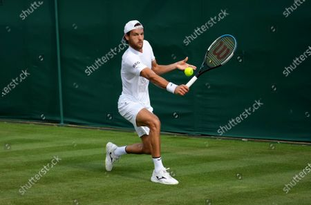 Portugal's Joao Sousa returns the ball to Italy's Andreas Seppi during the men's singles match on day one of the Wimbledon Tennis Championships in London