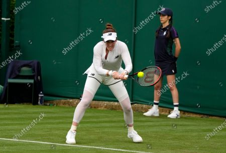 Madison Brengle of the US returns the ball to Christina McHale of the US during the women's singles match on day one of the Wimbledon Tennis Championships in London