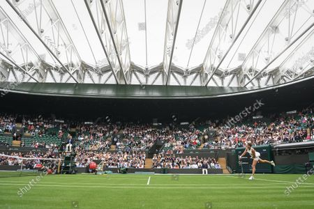 Aryna Sabalenka of Belarus (R) in action against Monica Niculescu of Romania during their first round match at the Wimbledon Championships tennis tournament in Wimbledon, Britain, 28 June 2021.
