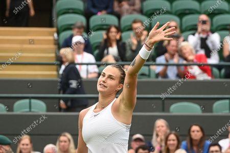 Aryna Sabalenka of Belarus celebrates winning against Monica Niculescu of Romania during their first round match at the Wimbledon Championships tennis tournament in Wimbledon, Britain, 28 June 2021.