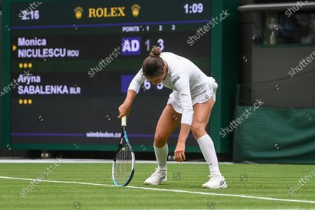 Stock Image of Monica Niculescu of Romania in action against Aryna Sabalenka of Belarus during their first round match at the Wimbledon Championships tennis tournament in Wimbledon, Britain, 28 June 2021.
