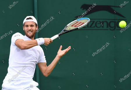 Joao Sousa of Portugal in action against Andreas Seppi of Italy during the 1st round match at the Wimbledon Championships, Wimbledon, Britain 28 June 2021.