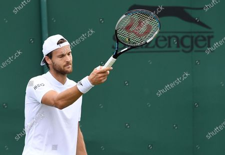 Stock Photo of Joao Sousa of Portugal reacts during the 1st round match against Andreas Seppi of Italy  at the Wimbledon Championships, Wimbledon, Britain 28 June 2021.