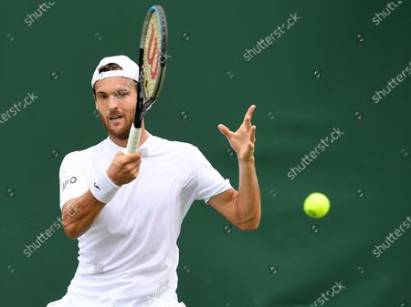 Stock Picture of Joao Sousa of Portugal in action against Andreas Seppi of Italy during the 1st round match at the Wimbledon Championships, Wimbledon, Britain 28 June 2021.