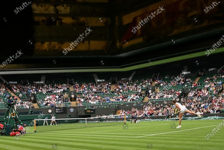 Aryna Sabalenka (R) of Belarus serves to Monica Niculescu of Romania (L) during their first round match at the Wimbledon Championships tennis tournament in Wimbledon, Britain, 28 June 2021.