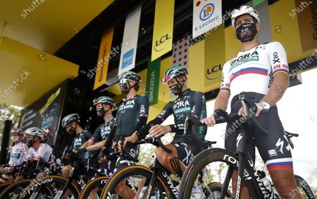 Slovakian rider Peter Sagan (R) of the Bora-Hansgrohe team and teammates before the start of the 3rd stage of the Tour de France 2021 over 182.9 km from Lorient to Pontivy, France, 28 June 2021.