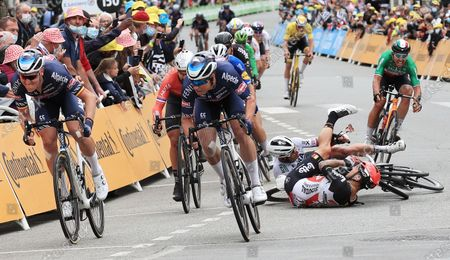 Australian rider Caleb Ewan (bottom foreground) of the Lotto Soudal team and Slovakian rider Peter Sagan of the Bora-Hansgrohe team crash shortly before the finish line of the 3rd stage of the Tour de France 2021 over 182.9 km from Lorient to Pontivy, France, 28 June 2021.