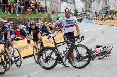 Slovakian rider Peter Sagan (C) of the Bora-Hansgrohe team pushes his bike off the street after a crash with Australian rider Caleb Ewan (bottom R) of the Lotto Soudal team shortly before the finish line of the 3rd stage of the Tour de France 2021 over 182.9 km from Lorient to Pontivy, France, 28 June 2021.