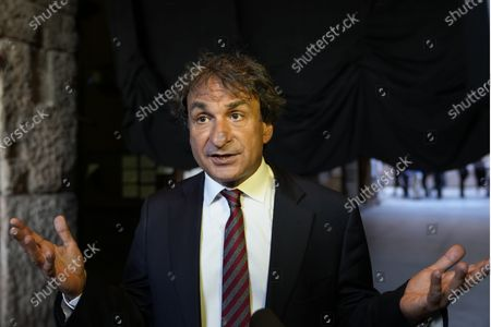 Orchestra director Marco Armiliato answers to the Associated Press during an interview at the Arena theatre, in Verona, Italy