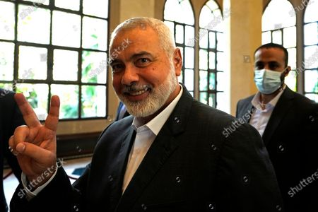 Ismail Haniyeh, the leader of the Palestinian militant group Hamas, flashes the victory sign before he speaks to journalists after his meeting with Lebanese Parliament Speaker Nabih Berri, in Beirut, Lebanon