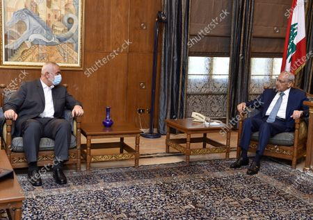 In this photo released by the Lebanese Parliament media office, Lebanese Parliament Speaker Nabih Berri, right, meets with Ismail Haniyeh, the leader of the Palestinian militant group Hamas, in Beirut, Lebanon