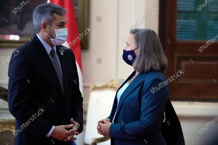 Under Secretary of State for Political Affairs Victoria Nuland, right, stands with Paraguayan President Mario Abdo Benitez as she arrives to the presidential office, Palacio de Lopez, for a meeting in Asuncion, Paraguay