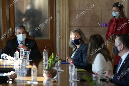 Under Secretary of State for Political Affairs Victoria Nuland, second from left, meets with Paraguayan President Mario Abdo Benitez, left, at the presidential office, Palacio de Lopez in Asuncion, Paraguay